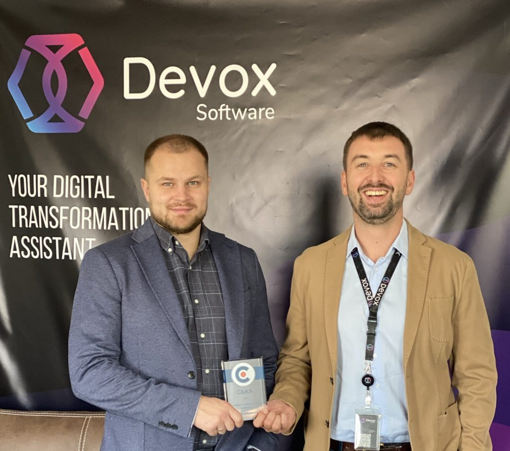 Devox Software top management with Clutch Leader award